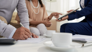 financial adviser showing customer plans